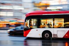 Driving bus in the city at night. Motion blur picture of a driving bus in the city at night Royalty Free Stock Photo