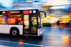 Driving bus in the city at night. Motion blur picture of a driving bus in the city at night Stock Image