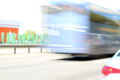 Driving bus in city traffic in motion blur.  blur background wit Royalty Free Stock Image