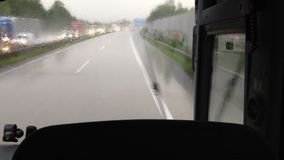 Driving with a bus through the rain on the autobahn stock video