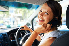 Driving businesswoman Stock Photo
