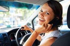 Driving businesswoman Stock Photo