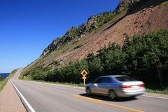 Driving on the Cabot Trail. A car driving on the Cabot Trail. Cape Breton Highlands National Park. Nova Scotia. Canada Royalty Free Stock Photos