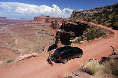 Driving in Canyonlands National Park. Car with mountian bikes enroute to the White Rim Trail in Canyonlands National Park, Moab, Utah Royalty Free Stock Photos