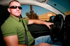 Driving a Car. A handsome man driving a car Stock Photo