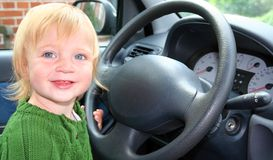 Driving car. Child or toddler drive car. boy sat in car by steering wheel Stock Photography