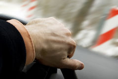 Driving car accident, winter road. Car driving skid accident, hand of a driver on wheel during car slip on winter road Royalty Free Stock Photo