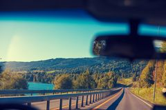 Driving a car along the fjord in Norway stock photos