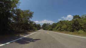 Driving  car on a asphalt road. Driving  car on a asphalt road, point of view front, real time. create by gopro stock footage