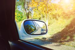 Driving a car on the autumn road. stock photo