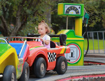 Driving car baby girl on road Stock Photos