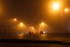 Driving a car in bad weather conditions. Heavy fog on the street, no car plates stock photos