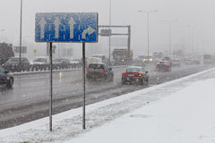 Driving a car in bad weather conditions, heavy snow fall Royalty Free Stock Images