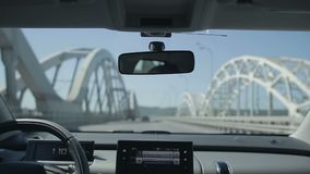 Driving car on the bridge in the city stock footage