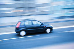 Driving car in motion blur Royalty Free Stock Photos