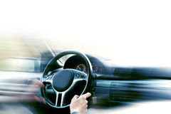 Driving  car. Close-up view of steering wheel and hands with white copy space Stock Images