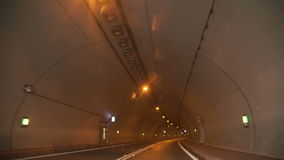 Driving car on coastal road through the tunnel. Morning mountain landscape in the summer season stock footage