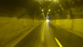 Driving car on coastal road through the tunnel stock video footage