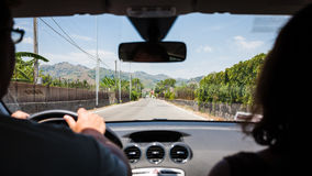 Driving a car in country region in Sicily Stock Images