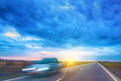 Driving car through countryside view through vehicle front winds Royalty Free Stock Image