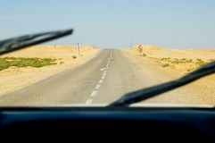 Driving car through desert Royalty Free Stock Photo