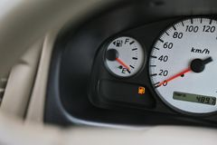 Driving car with digital oil gasoline level sign on the panel dashboard. Indicates that oil fuel is running low Royalty Free Stock Images