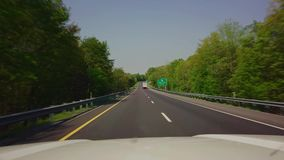 Driving in car down highway stock video