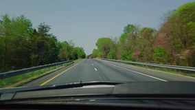 Driving in car down highway stock footage