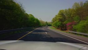 Driving in car down highway stock video footage