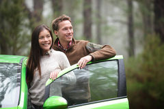 Driving in car - driver couple resting looking. In forest taking break in green rental cars during during road trip travel vacation holiday in beautiful Royalty Free Stock Photos