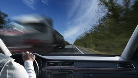 Driving car. Driver in car holding steering wheel. Blurred road and sky Royalty Free Stock Image