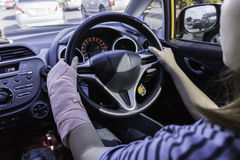 Driving car on empty road,Driving splint hand Royalty Free Stock Photos