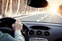 Driving car on empty road Stock Images