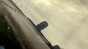 Driving A Car Really Fast. Camera Attached To The Car Door From The Outside - Driving stock footage