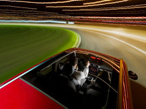 Driving a car fast at night Stock Images