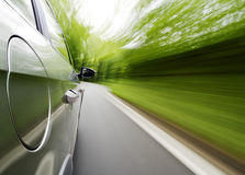 Driving a car. Car driving fast on the road Royalty Free Stock Photos