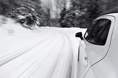 Driving a car. Car driving fast on snow Royalty Free Stock Photo