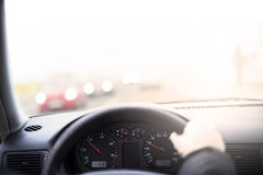 Driving a car, first person view. Focus on clocks. Royalty Free Stock Images