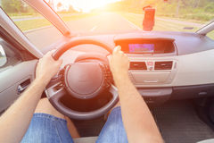 Driving a car - first person view Royalty Free Stock Photo