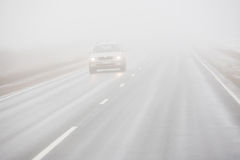 Driving car in the fog Stock Image