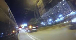 Driving on a night city street. Blurred motion time lapse. View from outside of the cabin. Driving car at high speed through the night city street and frequent stock footage