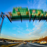 Driving in car on highway Royalty Free Stock Images