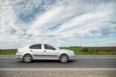 Driving a car on highway. Motion blur Royalty Free Stock Photos
