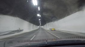 Driving a car through illuminated underwater tunnel. In northern Norway stock video footage
