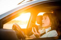 Driving car with mobile phone Royalty Free Stock Photography