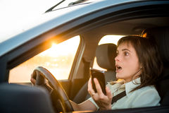 Driving car with mobile phone Stock Image