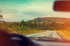Driving a car on the mountain road stock photos