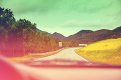 Driving a car on a mountain road stock image