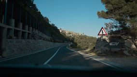Driving a car on mountain road. Road among mountains with dramatic stormy cloudy sky. Landscape. Beautiful nature. Croatia slow motion stock video footage