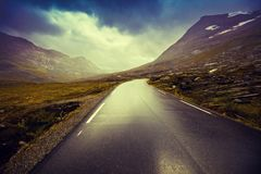Driving a car on mountain road royalty free stock photo